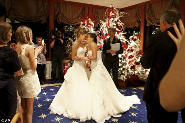 Mary Davidson, 27 (left), and Monica Rozgay, 29, said 'I do' in Seattle on December 9, 2012, four days after gay marriage was legalised by Washington state