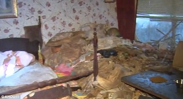 Shocking: Mounds of rubbish were in every room of the home, where the sisters and 130 cats had been living