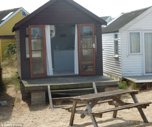 This tiny beach hut on Mudeford Spit in Christchurch, Dorset with no running water or mains electricity has been put up for sale for £150,000