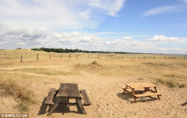 The view from the hut on Mudeford spit looks out across Christchurch harbour on to Avon beach
