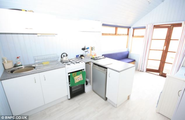 The cooker and fridge in the kitchen of the beach hut run off a small camping gas bottle as there is no mains electricity connected to it