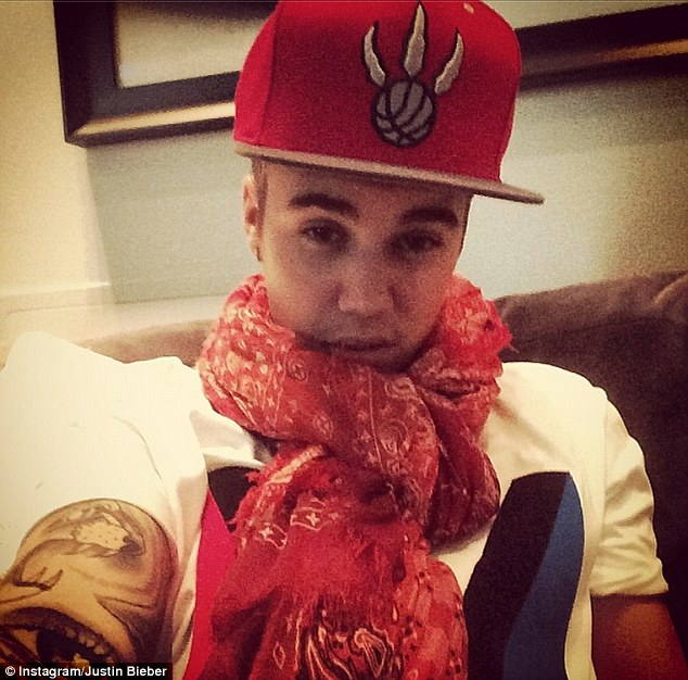 Red-hot romance: Justin Bieber shared a selfie on Monday seemingly pointed at his 'elegant princess' Selena Gomez