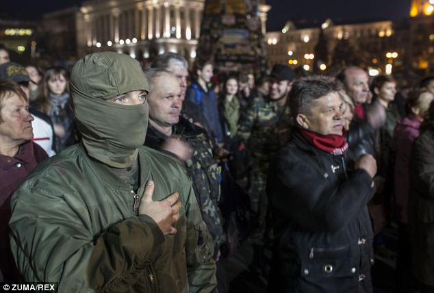 Hard line: Since late November, huge crowds have been camped out in central Kiev, opposing the government's partnership with Russia and calling for early elections