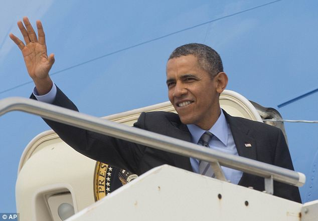 Another warning: And as Kiev reeled from the night's unruly demonstrations, U.S. resident Barack Obama (pictured boarding Air Force One in Rome today) issued yet another shot across Russia's bows, demanding it takes steps to reduce tensions in Ukraine now