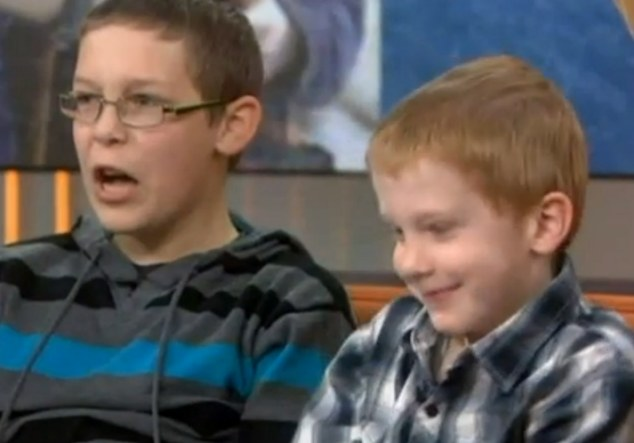 'Disgusting crime': Corbin and Dylan Crawford, aged 12 and seven, from Ford Dodge, were burgled while they were in New York to appear on the Today Show