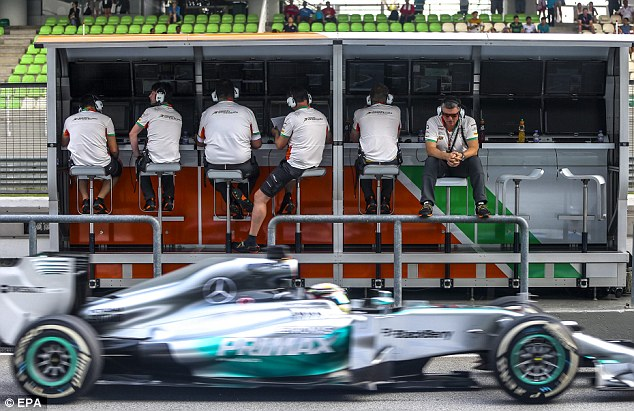 Did you hear that? Mercedes star Lewis Hamilton drives past the Force India pit-wall on Friday