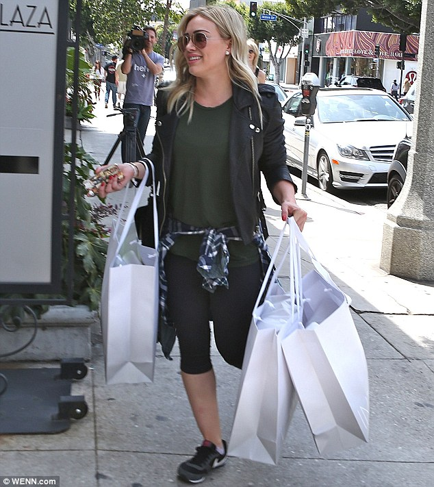 Even more gifts? Hilary shopped up a storm after her gym session