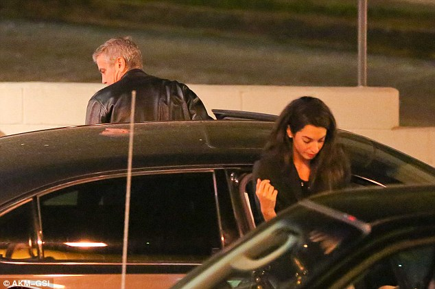 Disembarking: George and Amal got out of their car and prepared to head into the restaurant to meet with Emily and John