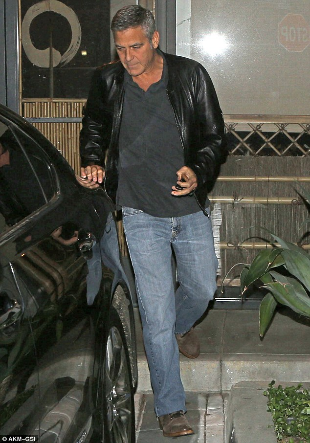 Edgy chic: George wore a black leather jacket over a dark grey top, teamed with light blue jeans, and brown Oxford shoes