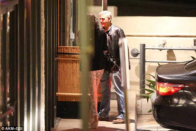 What a gent! The Descendents star opened the door for Amal as they entered the restaurant