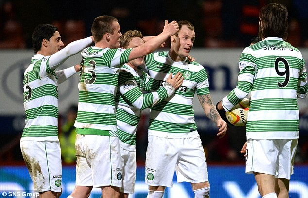 Unstoppable: Anthony Stokes is congratulated by his team-mates after scoring his second against Partick Thistle