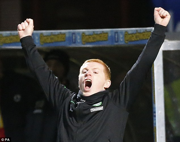 Unbridled joy: Neil Lennon shows his delight as Celtic claimed their third consecutive title