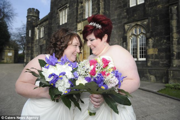 Tied the knot: Sarah-Louise Billington, 23, (right) became the youngest married lesbian in the UK after saying 'I do' to her 31-year-old fiancée Rebecca Green at Dudley Register Office today wearing wedding dresses
