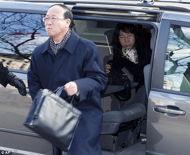 Tears: York University student Liu Qian's father Liu Jianhui and mother Zheng Yaru, right, broke down in tears  in court as the verdict was announced on Monday. They are pictured here in Toronto on Monday, March 24, 2014