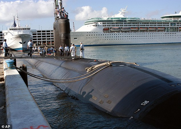 In better times: The USS Miami SSN 755, homeported in Groton, Conn., arrives in port in 2004 in Fort Lauderdale, Fla.