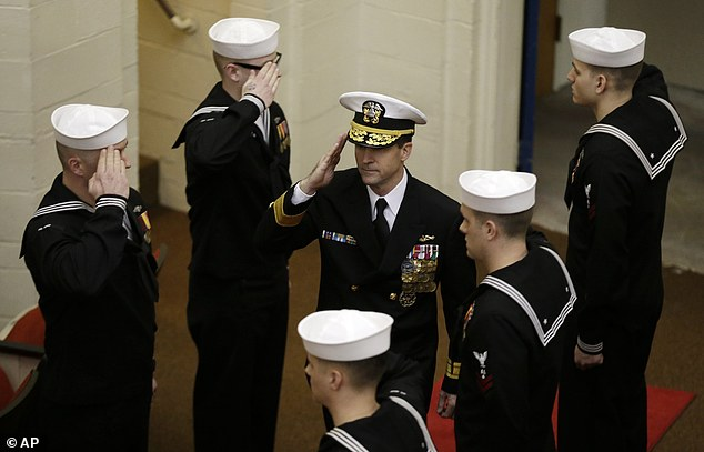Sending off: Rear Admiral Ken Perry arrives at the decommissioning ceremony for the fire-damaged USS Miami nuclear submarine at the Portsmouth Naval Shipyard, Friday, March 28, 2014, in Kittery, Maine