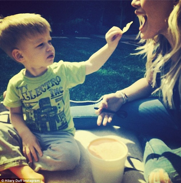 Kids will be kids! Hilary shared a picture of her son feeding her earlier but joked that '#mommydoesntneedchips'