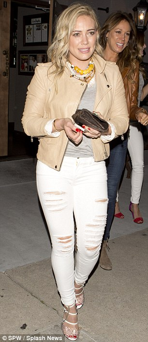 Hard work pays off! The star showed off her lean limbs in skinny jeans and a fitted leather jacket