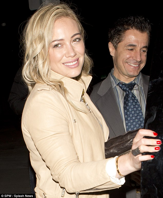 Natural beauty: Hilary hardly wore make-up for her evening out but looked gorgeous