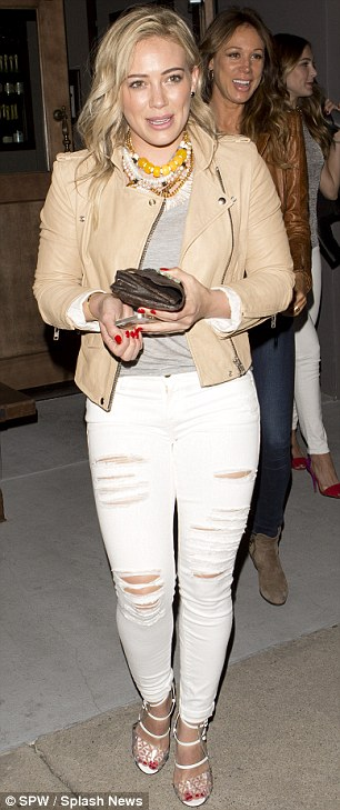 Tidbits of colour: Hilary opted to wear a chunky necklace with yellow beads and had bright red nail polish
