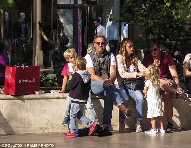 Happy family: Kevin and the handbag designer have three children - Cayden, 7, Hayes, 5, and Grace, 4