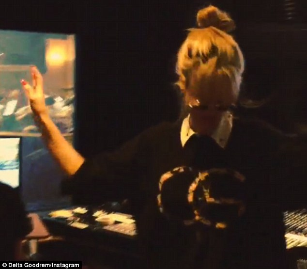 In the groove: Delta posted a video of herself dancing in the studio this week, while wearing John Lennon-esque glasses