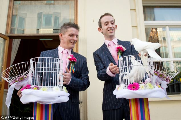 Colourful: In a pink and rainbow-themed ceremony, Phil Robathan (left) and James Preston released doves