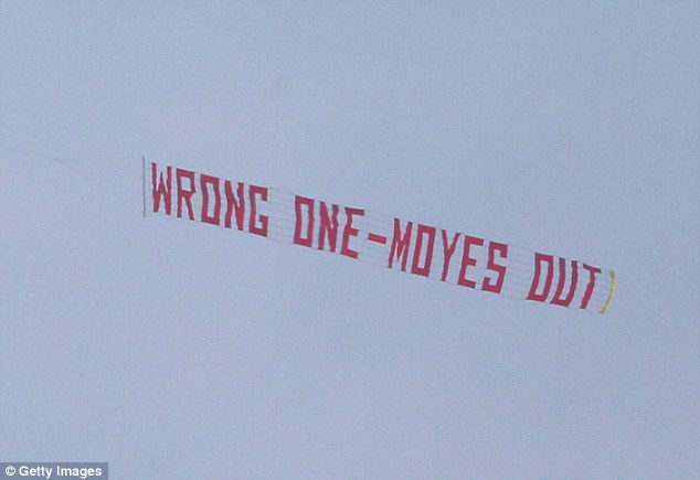 Protest: Disgruntled supporters flew a banner over the stadium ahead of the lunchtime kick-off