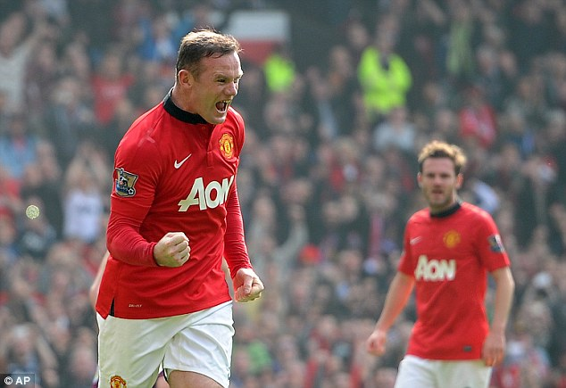 At the double: Wayne Rooney scored a brace to ease the pressure on his manager