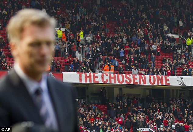 Sign of the times: Moyes stands in front of the 'Chosen One' banner that has come under criticism from fans