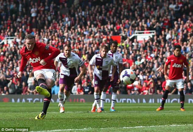 On the spot: Rooney nets his second goal with a well taken penalty after Juan Mata was brought down