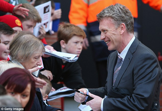Stand by your man: Moyes was given a warm reception by most United fans, despite his struggling season