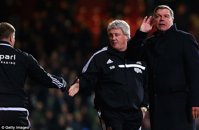 Not impressed: Sam Allardyce cups his ear after fans booed West Ham following the club's win over Hull