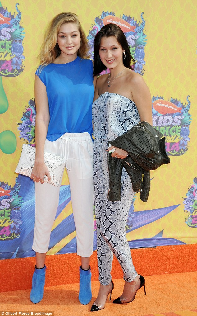 It runs in the family: The Sports Illustrated model was accompanied by her sister Bella , 17, who looked summery in a strapless snake-print jumpsuit and stiletto heels
