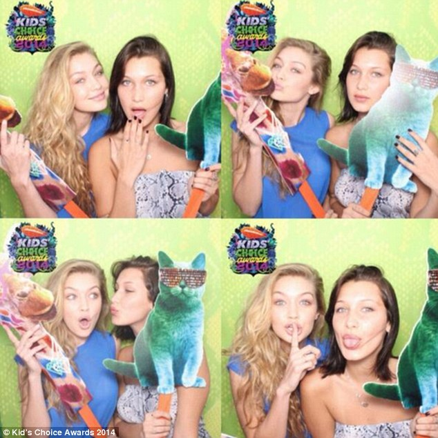 Backstage antics: Gigi and Bella pulled faces as they posed for pictures with cutout animals