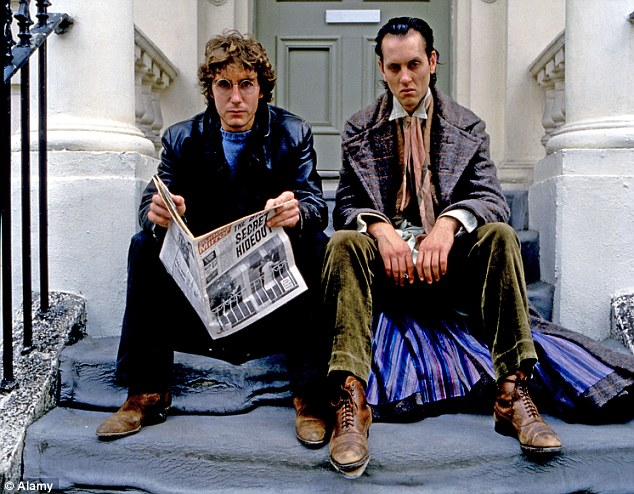 Cult classic: Grant (right) dressed just as unusually with Paul McGann in Withnail and I (1987)
