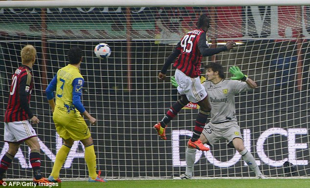 Leap of faith: Balotelli jumps to head Milan into the lead after just four minutes at the San Siro