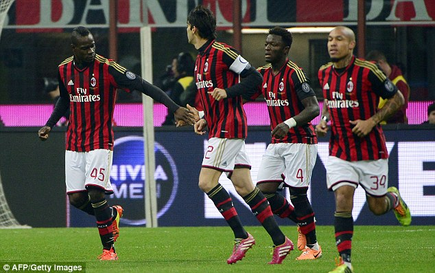 Winner: Balotelli (left) celebrates with his team-mates after scoring for Milan on Saturday