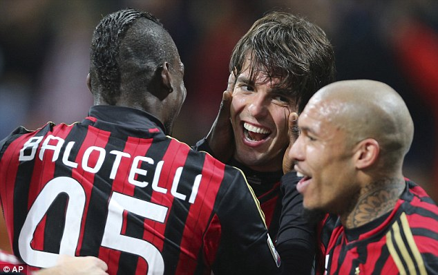 Double: Kaka (centre) scored twice on his 300th appearance for The Rossoneri
