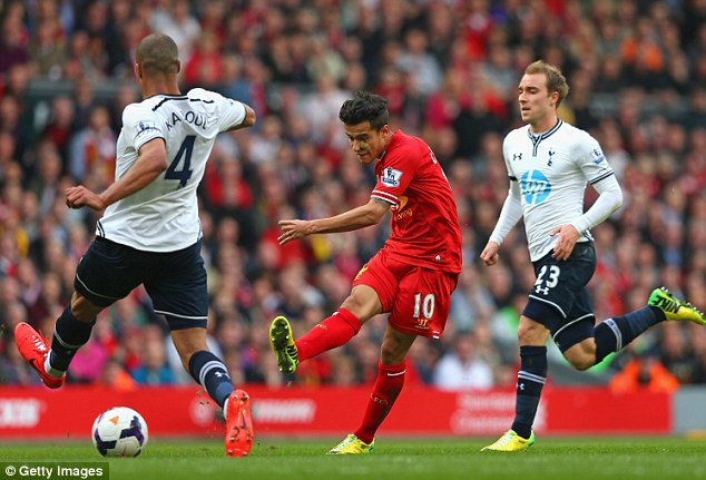 Strike: Philippe Coutinho scores Liverpool's third with a strike from outside the box