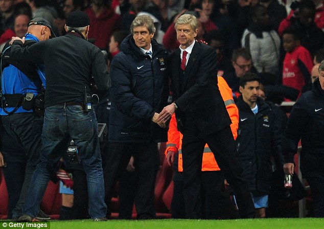 Mutual respect: Manuel Pellegrini shakes hands with Arsenal manager Arsene Wenger at the Emirates