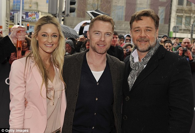 Irish welcome: Ronan Keating and his girlfriend Storm Uechtritz meet Crowe at the premiere in Dublin
