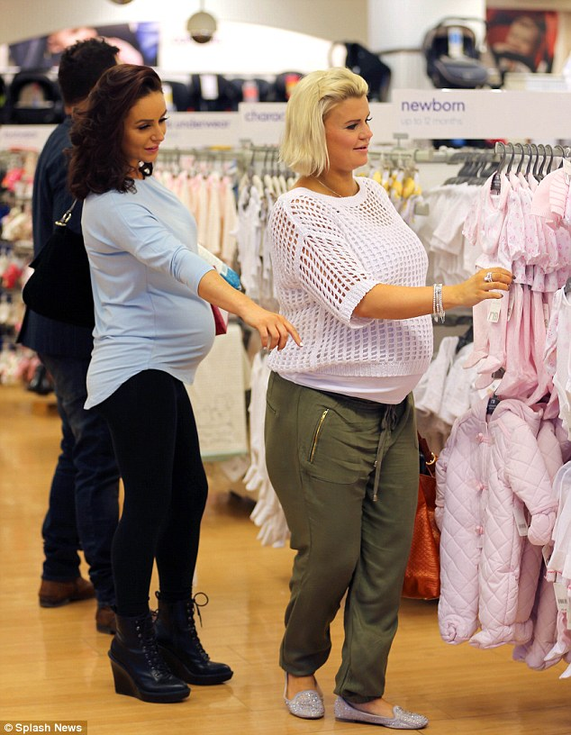 It's a girl: The heavily pregnant ladies were soon distracted by the adorable babygro outfits on offer