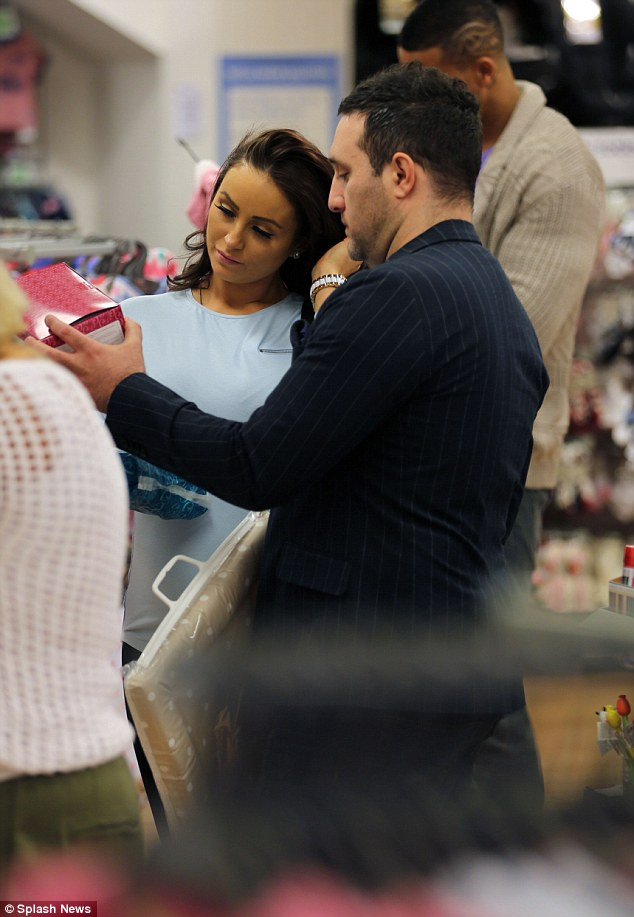 That's nice: Anthony and Rosanna seemed taken with one particular item as they queued to pay for their purcahses