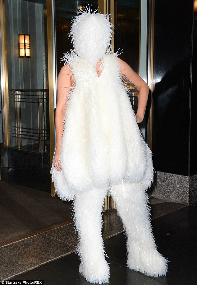 Abominable snowman? Earlier Sunday, the Do What U Want singer stepped out in a mask, dress, and thigh-high boots literally covered in white stringy fur