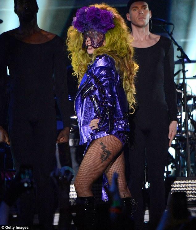 Working it: Gaga had a funky purple custom DKNY look for the show