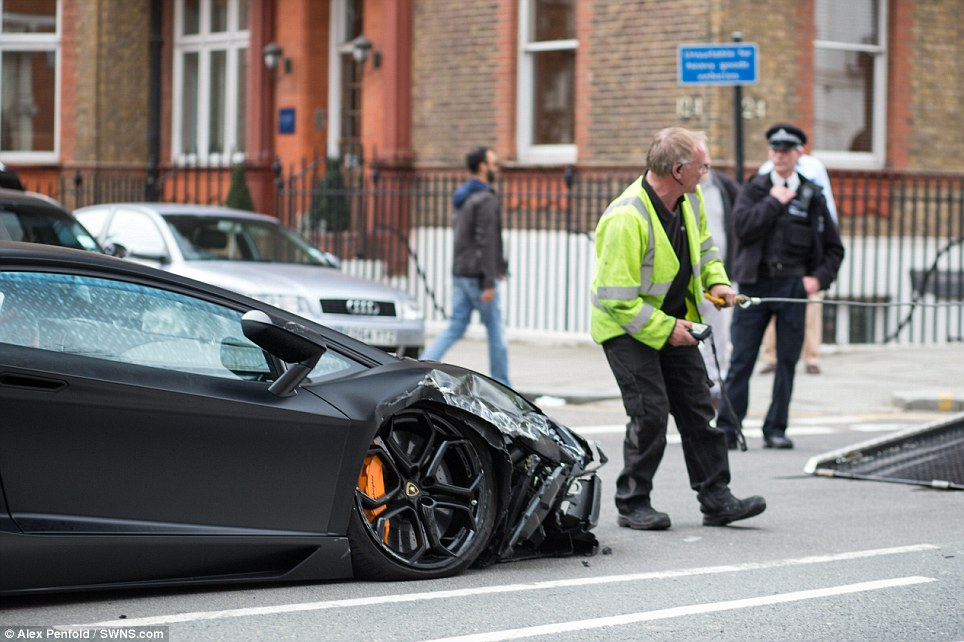 Recovery effort: The Metropolitan Police closed the road in Central London in both directions for almost an hour following the crash