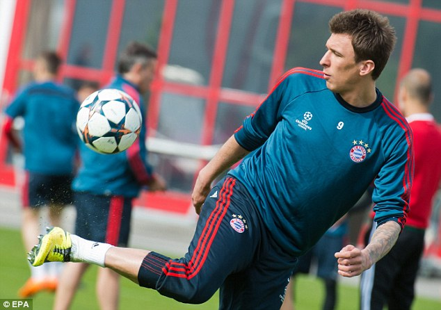 Top side: Striker Mario Mandzukic will pose a huge threat to United at Old Trafford on Tuesday night