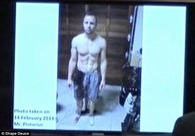 Aftermath of the killing: This picture of Oscar Pistorius, bare-chested and covered in blood from the waist down, was taken by police shortly after the Paralympian shot Reeva Steenkamp at his home