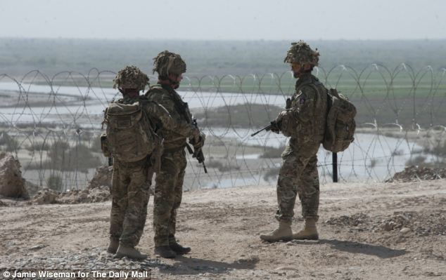Lt Col Richard Slack (centre), Commander of the 9/12th Royal Lancers, and Col John Mead (right) take a last look at the frontline of the Helmand river outside Sterga 2 Observation Post